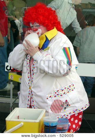 Clown Blowing Up A Balloon