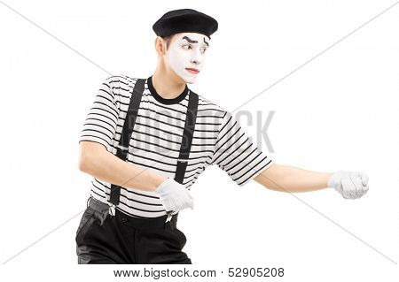 Male mime artist performing pulling virtual rope isolated on white background