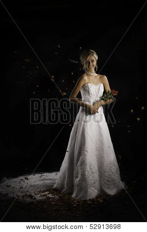 Beautiful happy bride holding bouquet of roses