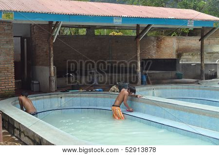 Unidentified Boy Cleans Pools At The Hot Springs