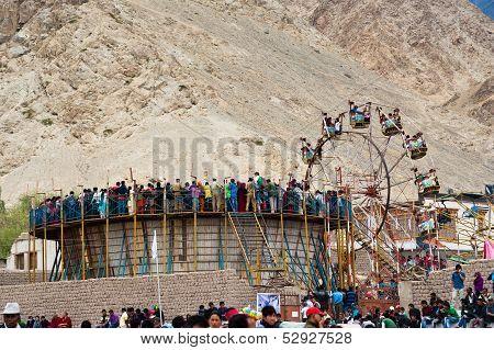 Tibetan People At Fairground Enjoying Ferris Wheel