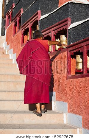 Buddhist Monk Rotating Praying Wheel.
