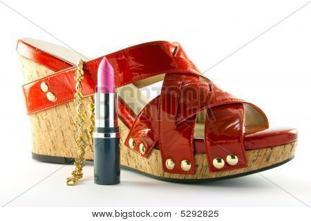 Red Shoe With Lipstick And Bracelet
