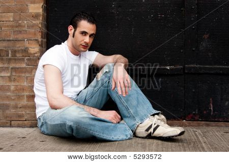 Man Sitting On Concrete