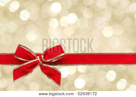 Red ribbon bow with bokeh,Christmas decoration.