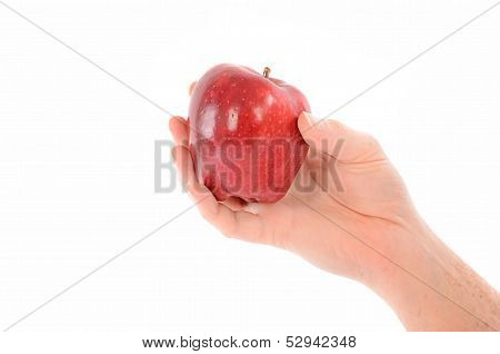 A Hand Holding A Red Apple On White