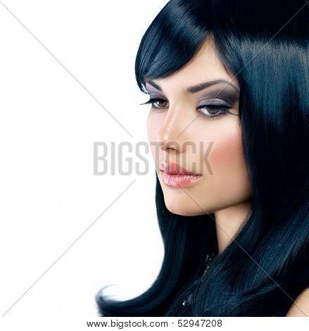 Beautiful Brunette Girl. Healthy Long Black Hair. Long Eyelashes. Fringe Hairstyle. Beauty Woman Portrait isolated on White Background. Smoky Eyes Make up. Perfect Skin