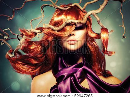 Red Hair. Fashion Model Woman Portrait with Long Curly Red Hair on Wood Branches. Autumn. Hair Extension