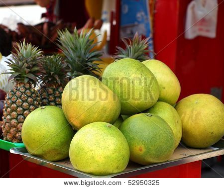 Large Pomelos And Pineapples