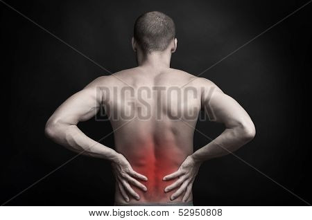 Man Holding Aching Back With Hands