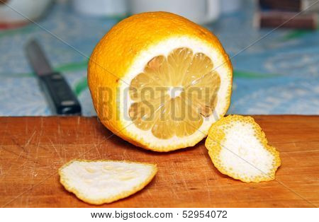 Lemon And Knife On The Table.