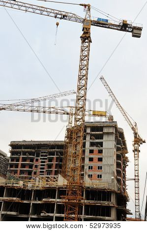 Site buildings under construction and cranes