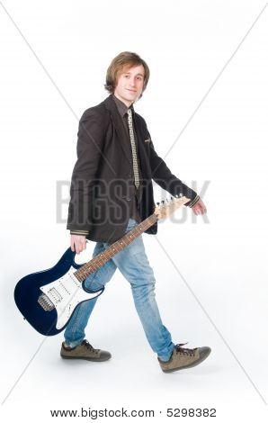 Man Walking With Electro Guitar