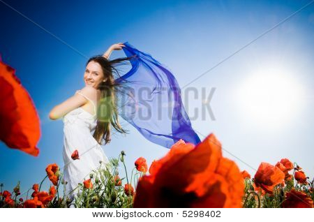 Attractive Girl In The Poppy Field
