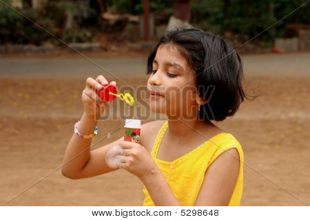Girl Trying To Blow The Bubble