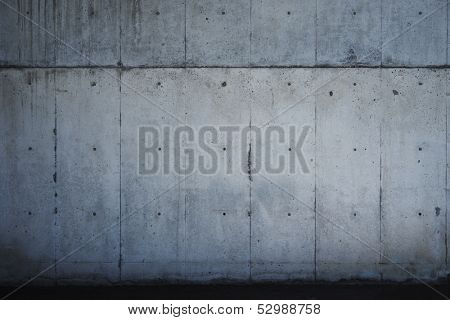 Dark concrete wall.