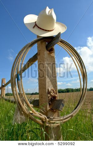 American West Rodeo Cowboy Hat and Lasso on Post