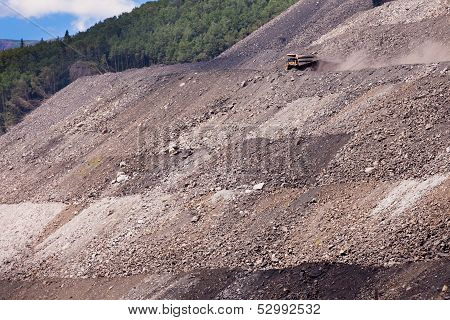 Mining Truck On Haul Road At Tailings Hill Side