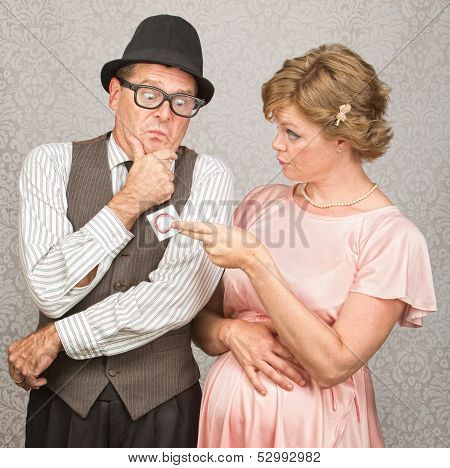 Nervous Man And Lady With Contraceptives