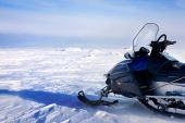 stock photo of ski-doo  - A snowmobile on a barren winter landscape - JPG