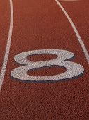 stock photo of 8-track  - Tight Shot of Number Eight on Running Track - JPG