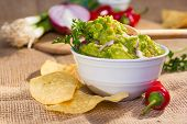 pic of southwest  - Southwest guacamole served with corn chips and pepper - JPG