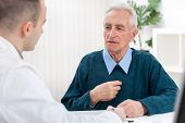 image of chest  - Senior man sits with his doctor and he complained of chest pain - JPG