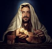 stock photo of gospel  - The Last Supper Jesus breaks the bread - JPG