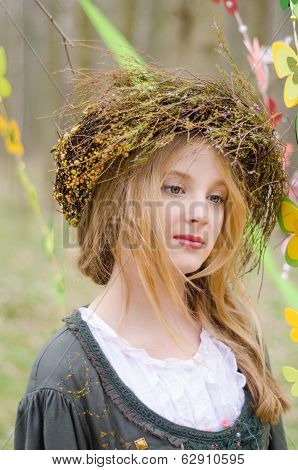 Close Up Portrait Of A Pensive Girl In A Folk   Circlet Of Flowers