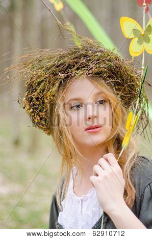Close Up Portrait Of A Girl In A Folk   Circlet Of Flowers Holding Garland Of Butterflies