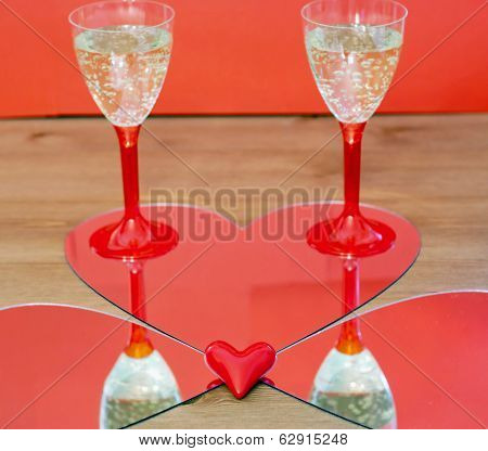 Mirroring Of Two Champagne Glasses And Little Heart