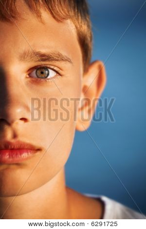 Surprised Teenager Boy Against Sea, Half Of Face