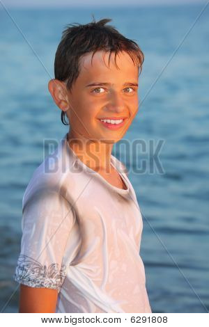 Teenager Boy In Wet Clothes On Seacoast