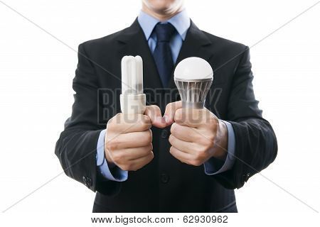 Businessman With Fluorescent And Led Lamps And Incandescent