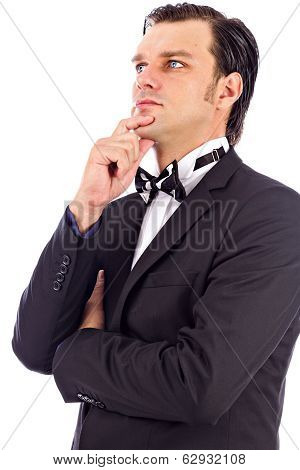 Portrait Of An Elegant Young Fashion Man  Looking Away With His Hand At His Chin And A Pensive Expre