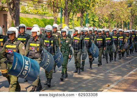 Phnom Penh, Cambodia - 29 Dec 2013: Cambodian Riot Police March On A Central Streets