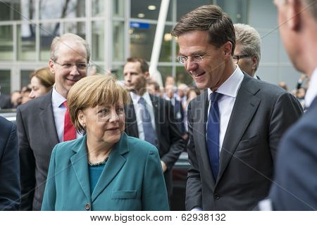 HANOVER, GERMANY - APRIL 7: German Chancellor Angela Merkel and Dutch Prime Minister Mark Rutte arriving at the Hannover Messe. April 7, 2014.