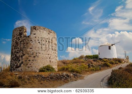 Two traditionnal old wind mills on MIlos island in Greece