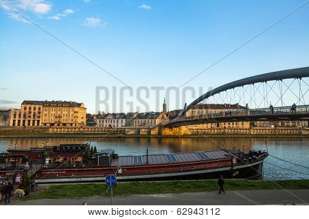 KRAKOW, POLAND - APR 7, 2014: Footbridge Ojca Bernatka - bridge over the Vistula River. Bridge is 145 meters /700 tons, the cost of its construction is more than 38 mil Polish zloty.