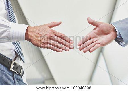 Photo of hands of business partners before handshake