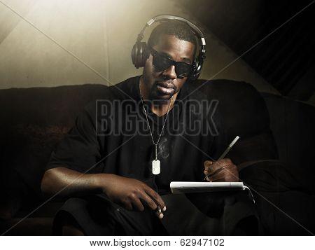 cool dj writing music in recording studio