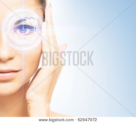 Young and attractive woman from future with the laser hologram on her eyes (collage about eye scanning technology)