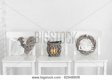 Rustic decor on a white shabby chic chair near the wall