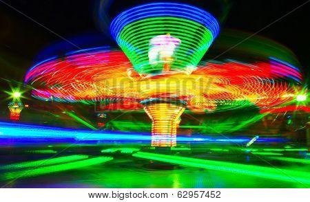 Rotating carousel in the fun park