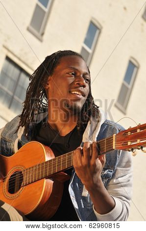 Young Male Musician Playing The Guitar