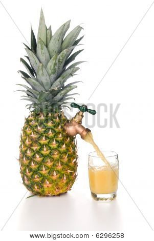 Pineapple Juice Pouring Into Glass