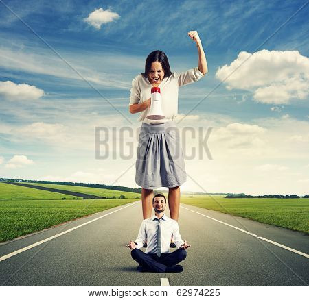 displeased woman and calm yoga man on the road