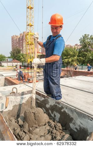 Worker kneads solution for bricklayers