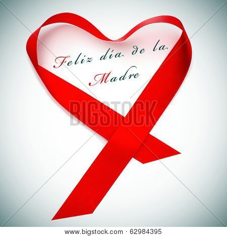a red satin ribbon forming a heart and the sentence feliz dia de la madre, happy mothers day written in spanish