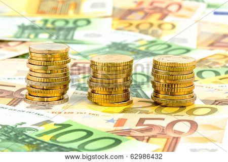 three stacks of money coins symbol photo for financial planning, investment and interest income
